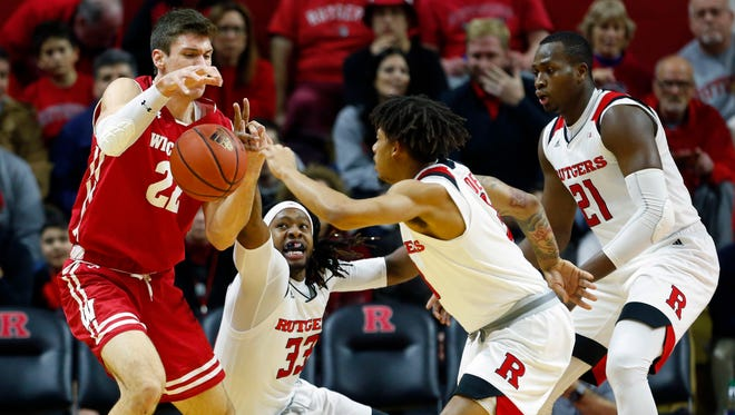 Ethan Happ is harassed by a trio of Rutgers players during their game Friday night. Happ had a season-high seven turnovers in the game.