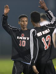 Green Bay East's Osman Abdi (10) celebrates a victory with Mohamed Abdi (12) Tuesday against Seymour.