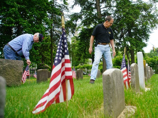 Vietnam veteran Ken Finlayson walks among the graves of Civil War veterans in the Wilmington and Brandywine Cemetery in Wilmington. Finlayson spent some 600 hours writing biographies for each of the Civil War veterans buried in the cemetery.