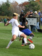 Vestal defender Jacob Wlostowski takes the ball away from Goshen's Zemi Rodriguez.