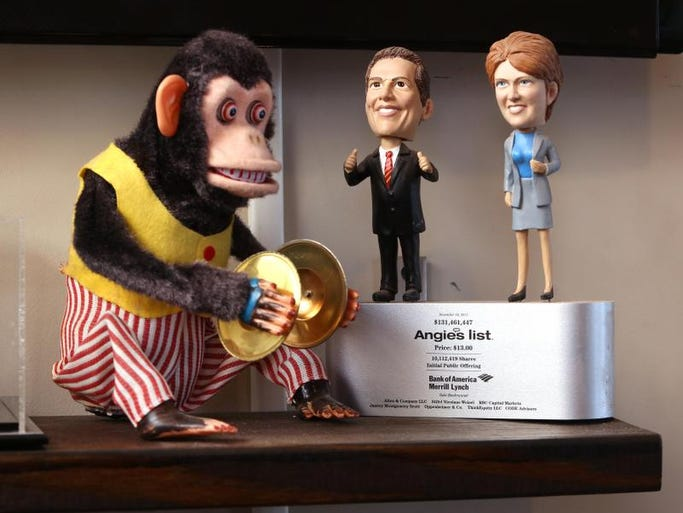 A batter-operated cymbal-playing monkey and Bobbleheads