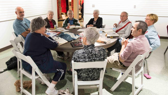 Members of the Presidential History Book Club discuss one of the books they read.