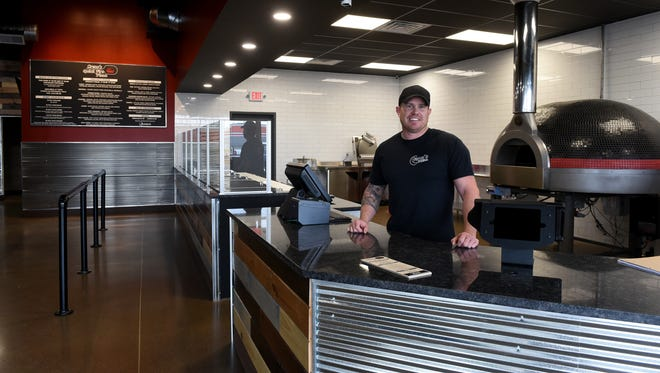 Shane Sensibaugh, one of the franchise owners of the new Creno's Quick Fire Pizza in Newark, in the restaurant which will feature a brick ovenfrom Italy.