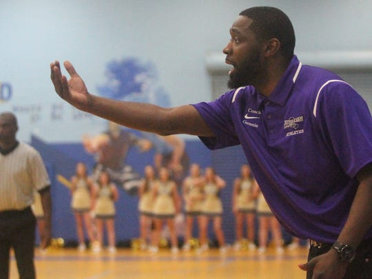 Crossroad basketball coach AnDonte Gennie gestures