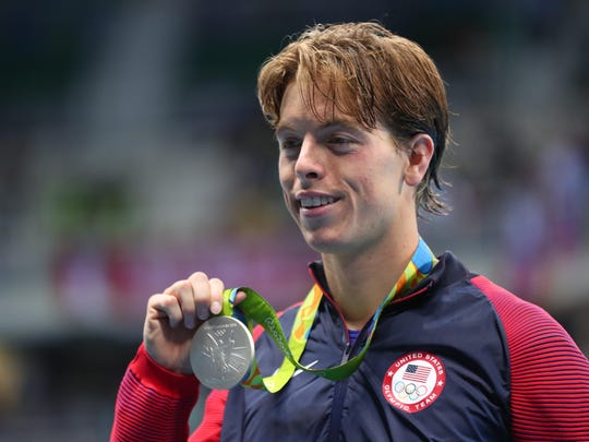 Connor Jaeger celebrates with his silver medal after the men's 1,500-meter freestyle in the Rio 2016 Olympic Games.