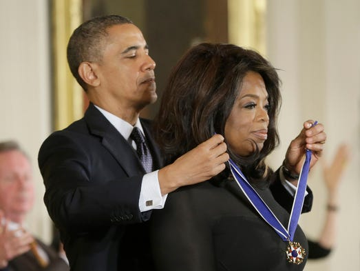 President Barack Obama awards Oprah Winfrey the Presidential Medal of Freedom, Wednesday, Nov. 20, 2013, in the East Room of the White House in Washington. (AP Photo/Pablo Martinez Monsivais)