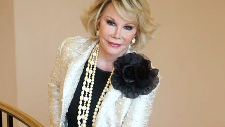 """This file photo shows Joan Rivers posing as she presents """"Comedy Roast with Joan Rivers """" during the 25th MIPCOM (International Film and Programme Market for TV, Video, Cable and Satellite) in Cannes, southeastern France. State health investigators say the Manhattan clinic where Rivers suffered a fatal complication during a medical procedure made several errors, including failing to keep proper medication records and snapping cell phone photos of her while she was unconscious. The comedian, who was 81, died Sept. 4, 2014."""