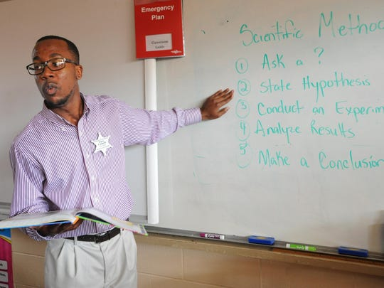 Deandre Council explains the Scientific Method to his third grade class at Shreveport's Westwood Elementary Wednesday.