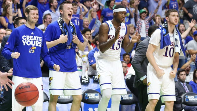 Kansas players react during their game Michigan State in the second round of the NCAA tournament.