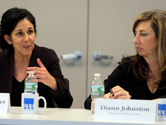 Linda Schwimmer (left) from the New Jersey Health Care Quality Institute and Diann Johnston from Monmouth Medical Center are shown during the Asbury Park Press Business Roundtable on health care affordability in Neptune.