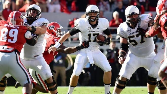 Vanderbilt quarterback Stephen Rivers (17) is sacked by Georgia Bulldogs linebacker Jordan Jenkins (59) during the first half at Sanford Stadium.