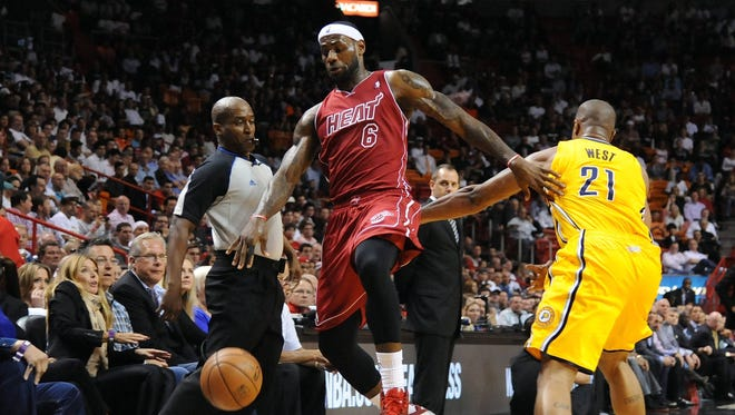 Heat forward LeBron James is fouled by Pacers forward David West during Wednesday's win.
