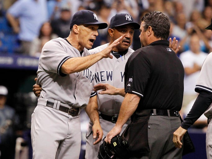 Sept. 16: Yankees manager Joe Girardi reacts with umpire Rob Drake after he was ejected in the eighth inning after Derek Jeter was hit. .