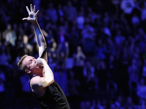 Macklemore performs onstage during Z100's Jingle Ball at Madison Square Garden on Dec. 13, 2013, in New York City.