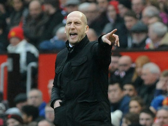 FILE - In this file photo dated Saturday, Jan. 7, 2017, Reading's manager Jaap Stam, gestures to his team from the sidelines during the English FA Cup Third Round match against Manchester United at Old Trafford in Manchester, England.  It is announced Wednesday March 6, 2019, that Stam has been appointed head coach of Dutch soccer team Feyenoord starting next season. (AP Photo/Rui Vieira, FILE)