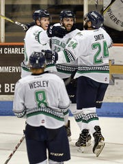 The Florida Everblades' Stephen MacAulay (from left) and Brant Harris congratulate teammate Dalton Smith after he scored Florida's 2nd goal, but the South Carolina Stingrays went on to win  4-2 in Game 4 of their South Division Kelly Cup final series Wednesday, May 3, 2017 at the North Charleston Coliseum. South Carolina leads the best-of-seven series 3-1. Wade Spees/Staff