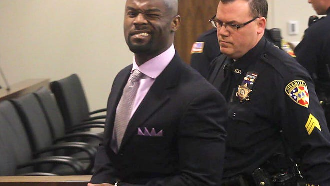Arthur E. Morgan III winks at the cameras as he is lead off to jail after being convicted of the murder of his daughter, Tierra Morgan-Glover, 2, in Superior Court in Freehold on April 3.