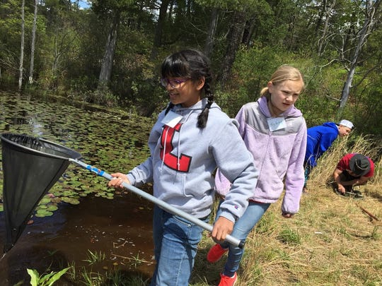 Samina Aziz of Mountainside and Sydney Geissler of Metuchen explore in the Pine Barrens