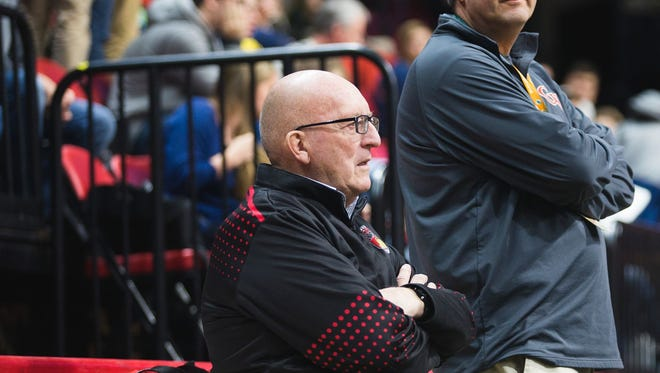 Ben Nelson, left, watches the court before the start of the Section 4 Class B girls basketball championship game at the Floyd L. Maines Veterans Memorial Arena in MArch 2017.