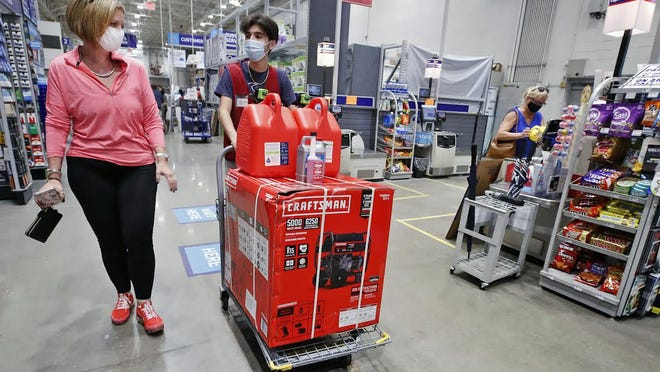 Angela Patel of Ormond Beach gets assistance with the purchase of a generator from Lowes while preparing for Hurricane Isaias, Friday, July 31, 2020.