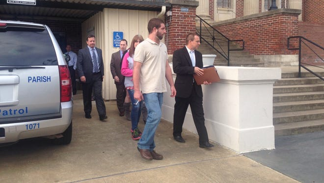 Chris Few (left) exits the Avoyelles Parish Courthouse in Marksville on Tuesday after the arraignments of Norris Greenhouse Jr. and Derrick Stafford. The two former Marksville Ward 2 deputy marshals will face separate trials later in 2016 for seriously wounding Few and the fatal shooting of his 6-year-old son, Jeremy Mardis.