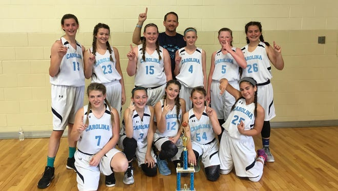 Team Carolina-Asheville's 13 and under girls basketball team won the Battle of the Champions tournament this past weekend in Winston-Salem.