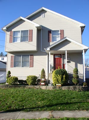 This three-bedroom Colonial at 220 S. 12th Ave. in Manville will be open to the public 1 to 4 p.m. Sunday, March 6.
