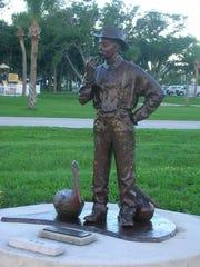 Rosalee Hume's statute of Paul Kroegel stands across from Riverview Park in Sebastian.