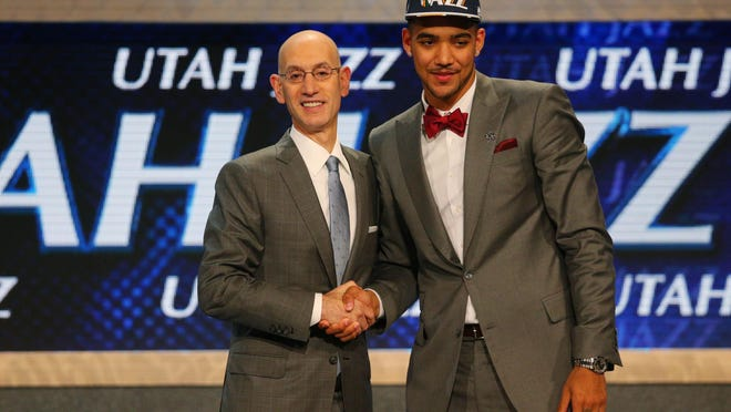 Trey Lyles greets NBA commissioner Adam Silver after being selected as the No. 12 overall pick to the Utah Jazz in the first round of the 2015 NBA Draft at Barclays Center.