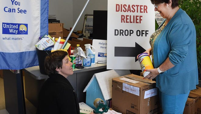 St. Landry-Evangeline United Way personnel, Dori Comeaux, left, and Ginger LeCompte, sort out supplies Wednesday morning donated for flood victims in Texas and Louisiana. The local agency join other agencies in collecting cleaning supplies, toilet and hygiene items as well as cash donations and gift cards that can be dropped off at United Way headquarters through Saturday at noon at 311 West Vine Street in Opelosas.