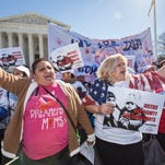 Immigration activists demonstrate in March at the Supreme Court in support of President Barack Obama's executive order.