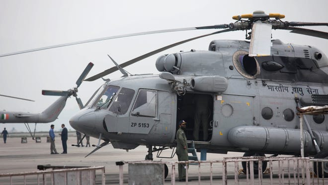 An Indian army helicopter is parked on the tarmac of the Katmandu international airport the day after the earthquake.