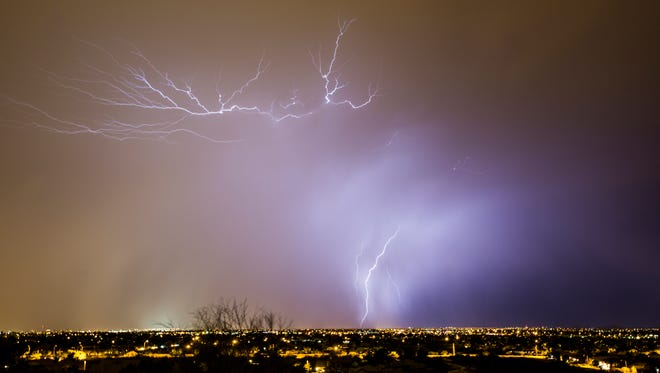 Lightning strikes in the West Valley as a monsoon storms sweeps over the Phoenix area, Monday, June 29, 2015, near Phoenix, Ariz.
