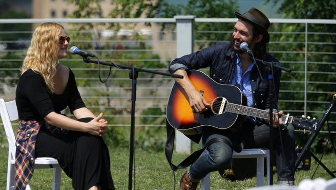 Adriel Denae and Cory Chisel perform at a Post-Crescent sponsored event at Riverview Gardens as musicians and fans wrap up Mile 3 of the Mile of Music festival in Appleton, Wis., Sunday, August 9, 2015.
