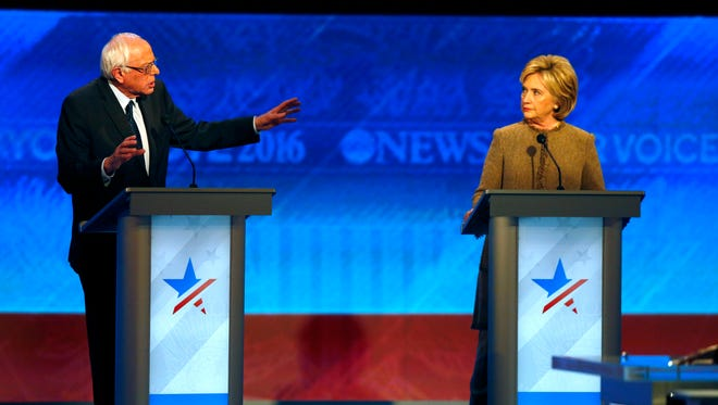 Bernie Sanders and Hillary Clinton on stage during a Democratic presidential primary debate Dec. 19, 2015, in Manchester, N.H.