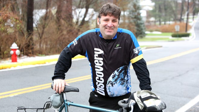 Ossining resident Rob Lowenthal, 55, who will be participating in the upcoming Climate Ride cycling trip in Southeast Asia, near his home on Tuesday.