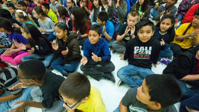 Students at University Hills Elementary School gathered for a 2016 celebration after being named state winner that year in Scholastic's summer reading challenge. This year, University Hills student won the honor again after logging 2,018,258 hours of reading time.