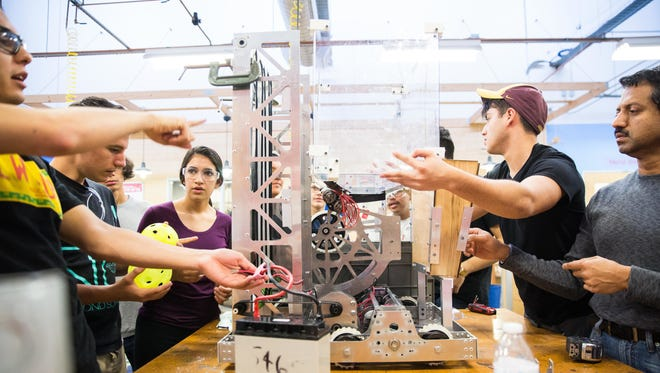 Members of the ASU student robotics competition team, Binary Bots, assemble their robot at TechShop Chandler, a community-based workshop and prototyping studio.