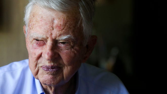 Bud Adams pauses during lunch in his home at his ranch in Fort Pierce on Nov. 24, 2014.