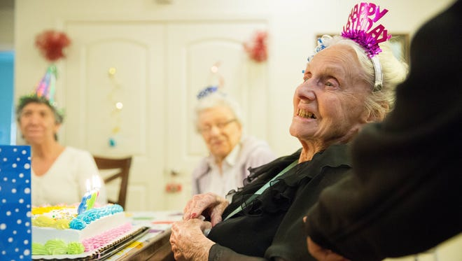 """Grace Shelton, smiles while residents and staff at Haciendas at Grace Village.sing """"Happy Birthday,"""" to her at her 103 birthday party ,  Tuesday Dec.5, 2017."""