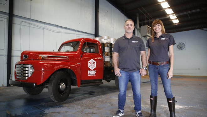 Proof Brewing Company Co-Founders Angela and Byron Burroughs pose Monday in the space that will become Proof's new home, the former Coca-Cola bottling plant on South Monroe Street.