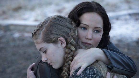 Katniss (Jennifer Lawrence) and Primrose Everdeen (Willow Shields) hug in a scene from 'The Hunger Games: Catching Fire.'