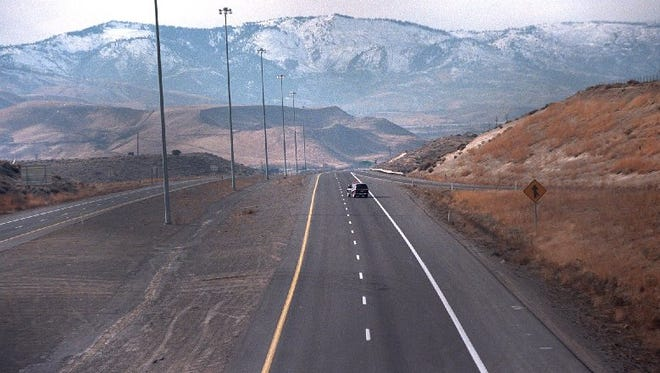 A NHP vechicle had Interstate 80 all to himself in this vew looking west from Robb Drive. The freeway was closed because a sniper was shooting at automobiles.