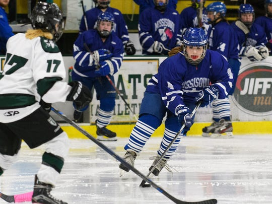 Missisquoi's Alyssa Audet (4) skates down the ice with