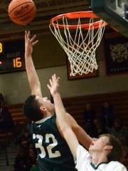 Williamston's Sean Cobb goes to the basket for two of his 11 points in a 58-55 loss at Howell on Tuesday, Dec. 12, 2017.
