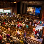 """Patrons gather in the all-weather pavilion at Peninsula Players Theatre in Fish Creek before the company;s performance of """"Sunday in the Park with George"""" during its 2013 season."""