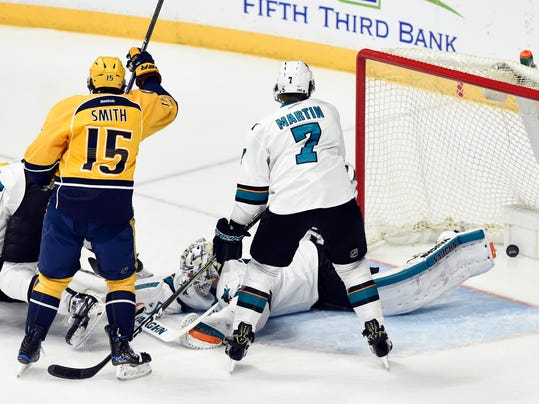 Nashville Predators right wing Craig Smith (15) celebrates after teammate Colton Sissons scored a goal against San Jose Sharks goalie Martin Jones (31) and defenseman Paul Martin (7) during the first period of an NHL hockey game Saturday, March 25, 2017, in Nashville, Tenn. (AP Photo/Mark Zaleski)