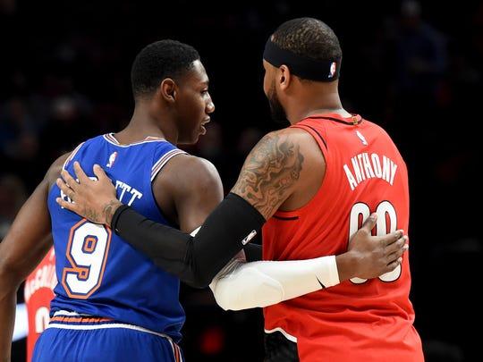 New York Knicks forward RJ Barrett, left, greets Portland Trail Blazers forward Carmelo Anthony before an NBA basketball game in Portland, Ore., Tuesday, Dec. 10, 2019. (AP Photo/Steve Dykes)