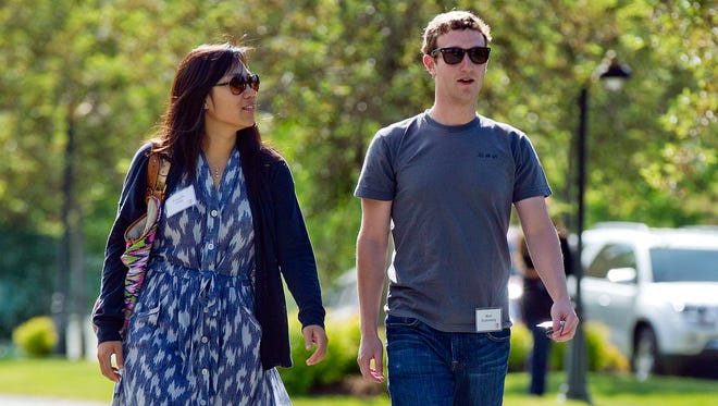 Mark Zuckerberg, president and CEO of Facebook, and his Priscilla Chan.