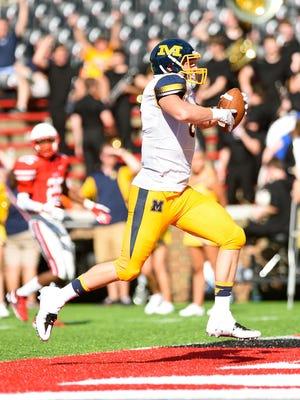 Matt Dotson catches a touchdown pass for Moeller. Dotson will play next season for Michigan State.